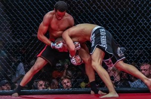 Shuler fighting off the cage in an MMA bout